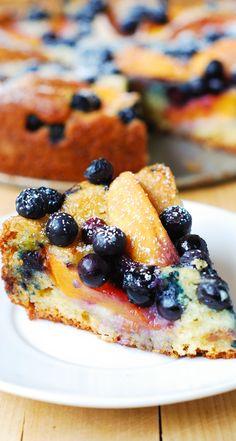 Delicious, light and fluffy Peach Blueberry Greek Yogurt Cake made in a springform baking pan. Greek yogurt gives cake a richer texture! #dessert #recipe