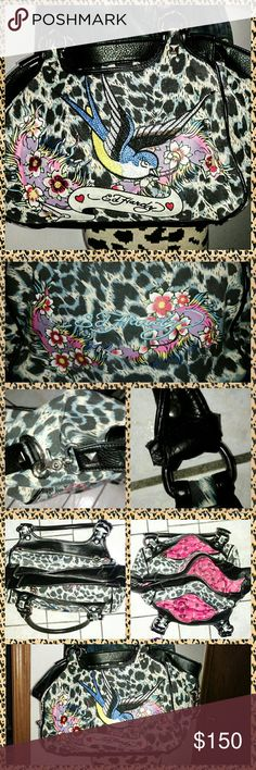 Ed Hardy Bag Limited Edition ~ Ed Hardy Bag  The Details On This Artwork is Sublime!  Excellent Animal Print Exterior   Beautiful Pink Lion Lining Throughout Interior  Interior Is 3 Sections For Optional Organization  Overall, Good Pre Loved Condition  View Last Photo  Leather Of Handles. Poking Out A Bit  Only Noticeable Upon Close Up Inspection  Does Not Effect Use Of Bag  Pls View All Images, As They Are Part of Description  Reasonable Offers Encouraged & Often Accepted Ed Hardy Bags…