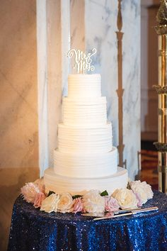 Four-Tier White Wedding Cake | Brides.com -- Absolutely amazing, I love this look, so simple and beautiful. IN LOVE.