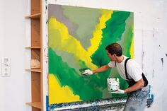 """Painter Stanley Casselman starts making his """"Gerhard Richter"""" inspired work by using a paint brush to apply color."""