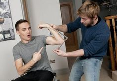 Liam getting measurements for wax figures. -I