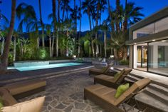 The backyard, pool and spa are fully walled and enclosed with lots of lush greenery providing a private, tropical feel. Plenty of seating, umbrellas and an outdoor kitchenette with large concrete bar seating area- complete with gas grill give you the Palm Springs outdoor living experience.