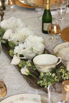 Centerpiece with teacup arrangements.....Rooted In Thyme