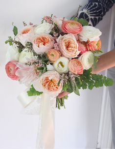 Bridal bouquet by designer Holly Rutt of Sweet Pea Floral – Michigan, with Juliet garden roses, coral ranunculus, café au lait dahlias, whit...