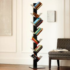 herringbone bookcase - it wouldn't even begin to hold my library but its cute!