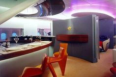 Curvy cocktail bar which boasts a super-size TV screen, cozy seating and private dining or relaxing zone in the luxuriously designed Airbus A380