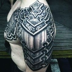 Tattoos are an integral part of society, with many people sporting one or more tattoos on their body, it is certain that these tattoos can be significant for many people and cultures from around th… Great Tattoos, Body Art Tattoos, Tattoos For Guys, Sleeve Tattoos, Shoulder Armor Tattoo, Shoulder Tattoos, Norse Mythology Tattoo, Historical Tattoos, Armour Tattoo