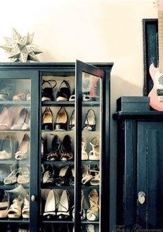 Displaying your shoes in in a bookcase creates a boutique effect in the bedroom and as an added bonus, the glass doors keeps dust off your shoes. For an affordable glass front bookcase check out going out of business sales at furniture stores, furniture consignment stores and estate sales.