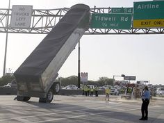 Image detail for -Bizarre accident causes big rig to get stuck on sign | PopScreen