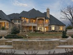 Nestled on 2.8 acres of gated grounds, this five-bedroom stone masterpiece offers luxurious living with exceptional views. A wrought-iron and glass entry compliments a curved wrought-iron front staircase. Outdoors is a loggia with a stone fireplace, pool, spa and sports court. A well supplies a pond and sprinkler system.