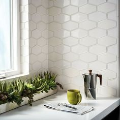 """3-1/2"""" x 6"""" Barbara Barry Frame collection elongated hex embossed edge and raised edge, MADE by ANN SACKS (backsplash)."""