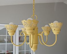 I'm so doing this!  Not yellow, but paper doilie shades...yes!  I have a new, shade-less chandalier I found on clearance at Lowe's just waiting for some DIY treatment.