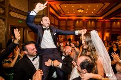 Groomsmen lift groom off ground during reception at Grand Del Mar #weddingphotography / see more at www.truephotographyweddings.com