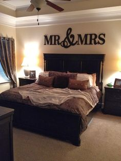Mr. and Mrs. sign above bed in master bedroom.