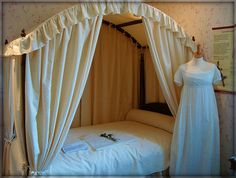 Jane and Cassandra's bedroom, with a typical dress that they might have worn in the house.