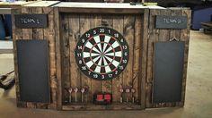 Dartboard Cabinet - Rustic, dark-stained cabinet with doors & scorekeeping for dart games Game Room Basement, Man Cave Basement, Basement Walls, Basement Ideas, Dark Stained Cabinets, Rustic Man Cave, Dart Board Cabinet, Ultimate Man Cave, Staining Cabinets