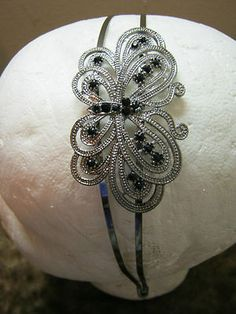 Large butterfly headband with black rhinestones! Love it! Only $7.00