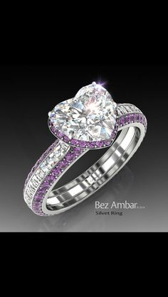 Kaylynn wants this ring, but instead of amethyst, she wants pink sapphires or another pink stone! Amethyst engagement ring - Silvet with a center diamond ,a frame of Amethysts and Blaze® diamonds on the shank. Heart Jewelry, Diamond Jewelry, Jewelry Rings, Fine Jewelry, Heart Ring, Diamond Heart, Jewellery, Jewelry Watches, Heart Shaped Engagement Rings
