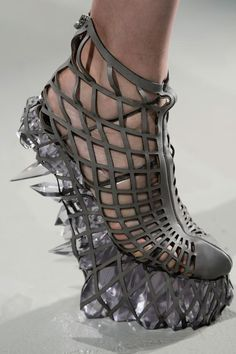Ice pick daggers? Clear quartz crystal? These could leave scars. Bandaides incuded?   Iris Van Herpen F/W 2015-16