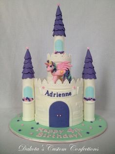 * Frosted in buttercreamwith fondant accents including the towers and pony figure.