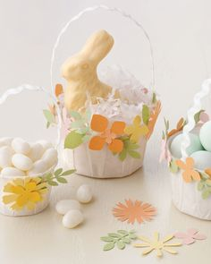 Easter Crafts: A lifting crafting tool magic can make all of the difference when it comes to this year's Easter baskets. Kids can use a variety of floral-shaped paper punches to transform paper cups into delightful Easter favor baskets.