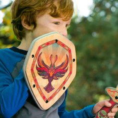 Handmade Wooden Toy Shield for Pretend Play in Raven Bird design. Real non-toxic wood and soft EVA foam. Made in Portland, OR. Matching Wooden Sword available. #woodentoys #toys #madeinUSA