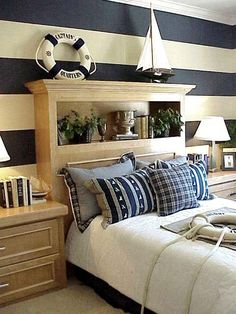 There are several ways to bring the ocean theme to your bedroom – these striped walls provide the perfect backdrop for an otherwise mellow nautical design.