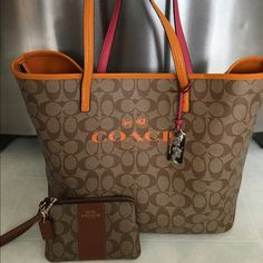 Coach Brown & orange tote & wristlet One of a kind bag! Purchased at Macy's at Christmas time for $295. Won't see many like this I've never seen one tbh. They no longer sell this purse that I know of. Outside is excellent! Inside does show ink marks and some dirt wear and tear. Wristlet only used a couple times. Coach Bags Totes