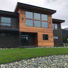 Nova Batu siding used on a contemporary style home in Alaska. Corrugated metal + Nova Batu results in a great contrast. House Cladding, Timber Cladding, Facade House, Cladding Ideas, Exterior House Siding, Exterior House Colors, Modern Exterior, Exterior Design, Pintura Exterior