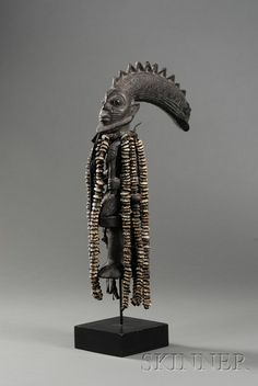 Africa | An Eshu Staff from the Yoruba people of Nigeria | Wood, cloth, leather and cowrie shells