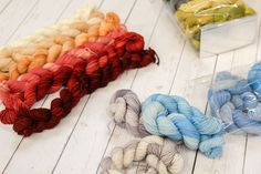 These Frolicking Feet gradient sets from Done Roving Yarn come packaged in cute plastic bags like candy!