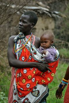 Kenya, Africa, I am so glad I got a baby bjorn, to carry Kaya, but these women of the Masai tribe just use their dress, I love it!