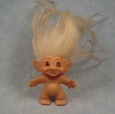 Vintage Thomas Dam Troll...These were the original troll dolls and the word DAM was stamped on the back of their necks. They had brown/amber glass eyes. I love them. I had one with yellow hair tipped in black that was an original. I wish I had one now.