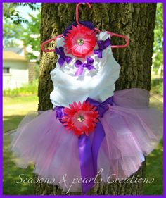 This  is a Dora  theme Tutu, shirt and headband set. What little girl wouldn't look beautiful in this little outfit? This  tutu is made with a blend of our most popular pinks and purples, sure to please every little princess, and is perfect for those special birthday celebrations, photographs, or just plain old every day twirling fun!    by Seasons & Pearls Creations