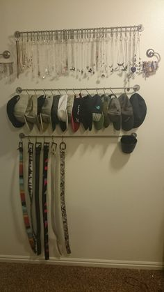Closet organization using Ikea Bygel products. Top rack for my necklaces, next row for hats and bottom belts. On either side are toilet paper holders for bracelets :)