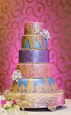 This week's Wedding Cake Wednesday is a charming color palette of aqua, watermelon pink, light purple...and gold!