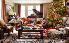 A spectacular tree--wrapped in yards and yards of lights and adorned with plenty of ornaments-- commands attention in the great room. - Traditional Home ®/ Photo: John Bessler / Design: Lisa Hilderbrand