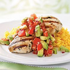 Avocado and tomato salsa over cilantro lime marinated chicken with fresh saffron rice- amazing. I paired it with some fresh steamed broccoli for some extra veggie power.