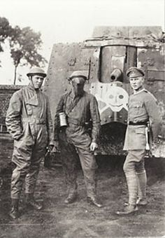Has to be WWI, no doubt and most likely British soldiers, although maybe Canadian or Aussies.  One of the early model tanks is in the background.