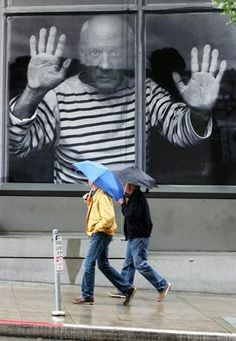 Two hands. Two umbrellas.