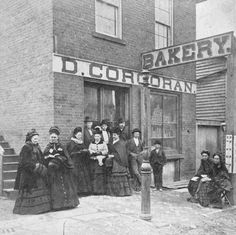 A small group of women gathered outside the doorway of the D. Corcoran Bakery in Mount Vernon, Ohio during the Women's Temperance Crusade of 1873-1874. Women's Temperance Crusade 1873-1874