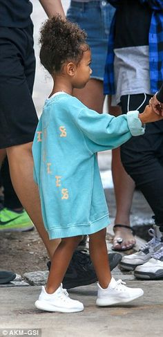 Just like Kim! North looked cute wearing a turquoise Yeezy 'The Life of Pablo' sweater and white sneaker