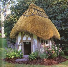 thatched roof - I want to live in a house with one.  maybe just a tad bit larger than this one!