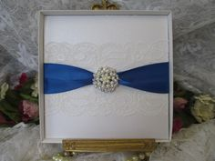 B188WSQ BOXED WHITE LACE WEDDING INVITATION ROYAL BLUE PEARL Beautiful Unique Handmade Wedding Stationery from www.vintagelaceweddingcards.co.uk