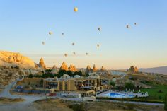 The Most Incredible Hot Air Balloon Ride EVER! Don't miss our latest post about our incredible sunrise hot air balloon ride over the fairy chimneys in Cappadocia, Turkey! -- LINK: http://www.pausethemoment.com/hot-air-ballon-ride-cappadocia/ -- LIKE/SHARE/COMMENT/PIN if you enjoy!
