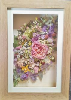 Moving house? We can make a frame of all your favourite flowers from your garden to take with you