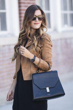 Black dress, leather jacket, and cute belt.