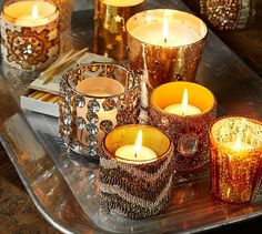 Group small candleholders in different styles on a tray for an eclectic + elegant coffee table vignette | Pottery Barn