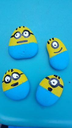 My first time painting Minions.. not too bad on rocks..