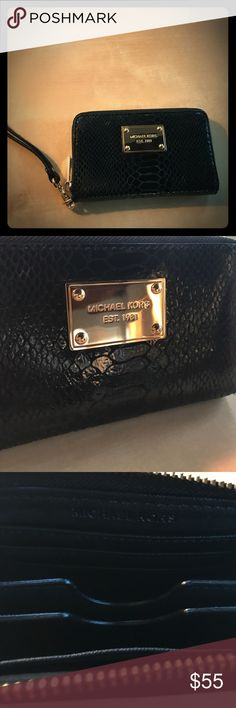 Michael Kors Black Leather Wristlet Wallet Perfect condition. Never used! No scratches on the gold Michael Kors emblem. Has dividers on the inside with slots for credit cards and ID. Can fit smaller iPhones. Michael Kors Bags Clutches & Wristlets